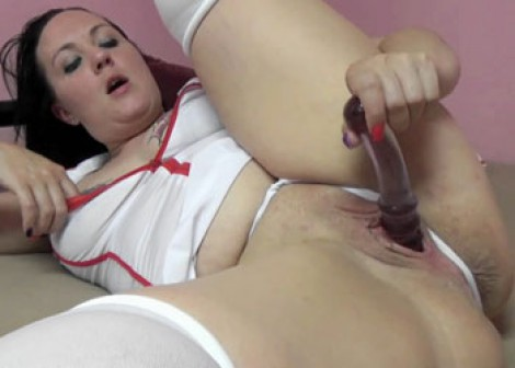 Selena Sky plays with her glass dildo